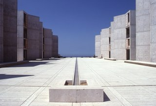 Design Icon: 9 Buildings by Louis Kahn - Photo 5 of 10 - Salk Institute (La Jolla, California: 1965)<br><br>Inspired by medieval monasteries, Kahn's masterful example of symmetry reinforces Jonas Salk's initial instinct; he famously met with the architect for consultative purposes but their conversation so impressed Salk that he knew he had found the right architect. The two rows of buildings are like curtains framing the ocean, and a simple dividing line offers as much serenity and contemplation as the horizon rising above the sea.