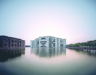The National Assembly Building in Dhaka, Bangladesh, was designed in 1962 by the famous American architect Louis Kahn, who was known for using concrete to create unique, bold forms that would have otherwise been impossible to construct.