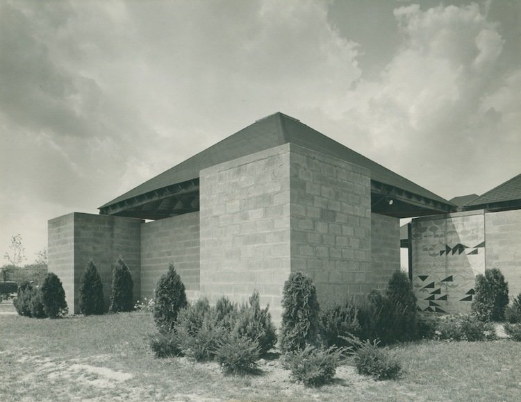 Jewish Community Center (Trenton, New Jersey: 1959)  Designed while Kahn was working on the Yale Art Gallery, this minimalistic structure appears to bring Roman design to New Jersey's capital. A crucifrom of four square buildings, topped with triangular forms, adds a dramatic, sweeping entrance to a simple visit to the pool.  Photo 8 of 10 in Design Icon: 9 Buildings by Louis Kahn