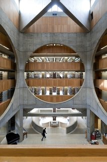 "Design Icon: 9 Buildings by Louis Kahn - Photo 9 of 10 - Library at Phillips Exeter Academy (Exeter, New Hampshire: 1972)<br><br>Kahn opened up the interior of this brick library with a ceiling clerestory, which allowed sunlight to flow in and colorfully contrast with the stone-and-wood interior. Illumination was a focus down to the smallest detail, such as the teak study corrals positioned in light-filled spots. It's a fitting response to the design committee's brief, which noted that ""the quality of a library, by inspiring a superior faculty and attracting superior students, determines the effectiveness of a school."""