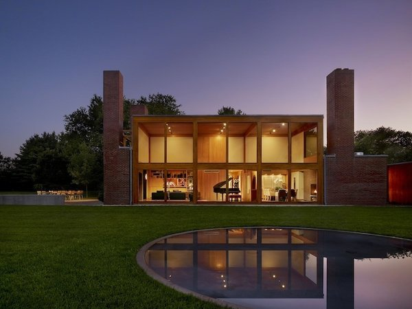 "Steven and Toby Korman House (Fort Washington, Pennsylvania: 1973)  Kahn's often pegged with being architect who imposed his will on a structure, but in the case of this home commission, a rare residential work, it's instructive to understand how far he went to make the home accommodate its inhabitants. The modified open floor plan respected the client's wish to ""be able to play touch football in every room,"" and the two-story glass facade helped an allergy-suffering owner experience the outdoors.  Photo 10 of 10 in Design Icon: 9 Buildings by Louis Kahn"
