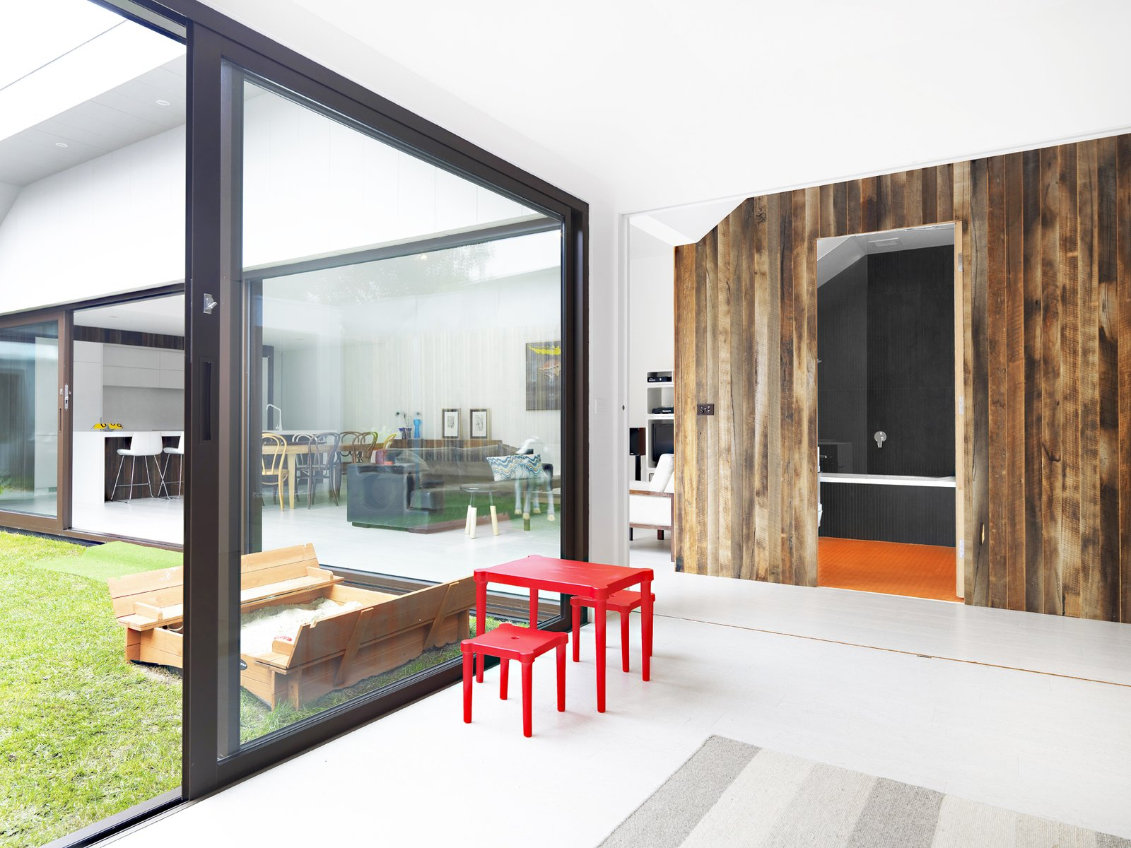 "Central to the design of the home from day one was the ""Dunny Block"", an Australian toilet historically found outside the home. The Dunny Block from the yard of the original home was incorporated into the interior program of the new home, now housing the new main floor bathroom. The block is clad in recycled messmate timber, and is a bold focal point of the living space.  Photo 10 of 11 in The Best Prefab Homes in Australia"
