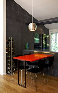 Modern Kitchen Renovation with Mid-Century Roots - Photo 4 of 6 - A new dining table, made from a leftover acrylic slab by 3form, sits on just the other side of the kitchen workstation. Photo by: Greg Powers