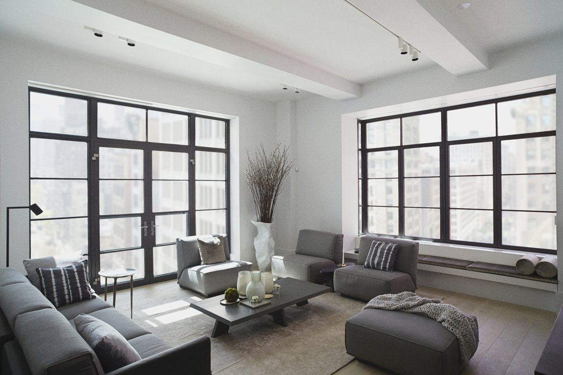 The Huys apartments come with electronically controlled solar shades with concealed window shade pockets and recessed lighting fixtures by Flos. Shown here, the living room of a two-bedroom unit.  Photo 3 of 6 in 5 Great Rooms from New Dutch Apartment Huys in New York City