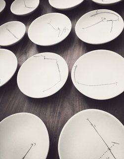 Cadena designed all the dishes, covering them with abstract, hand-drawn patterns inspired by his grandma's silverware.