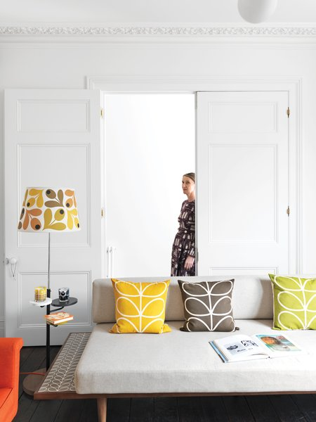 Living Room, Sofa, and Dark Hardwood Floor Textile designer Orla Kiely's renovated London Terrace House is punctuated by her distinctive palette and motifs.  Photo 1 of 5 in A Textile Designer's Home Is Unapologetically Colorful