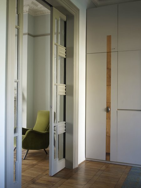 The doorways were widened to improve spatial flow. Sliding pocket doors from a 1950s French hotel were installed, and now feed into the living areas.  Photo 8 of 12 in A Gracious London Terrace House Is Reborn with Salvaged Materials