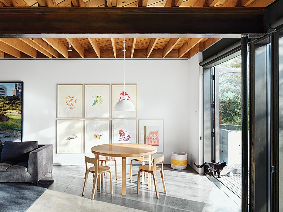 Dining Room, Table, Pendant Lighting, Concrete Floor, and Chair An Alvar Aalto table is surrounded by a quartet of the designer's Chair 65.  Photo 4 of 11 in This Bungalow is Anything but Basic