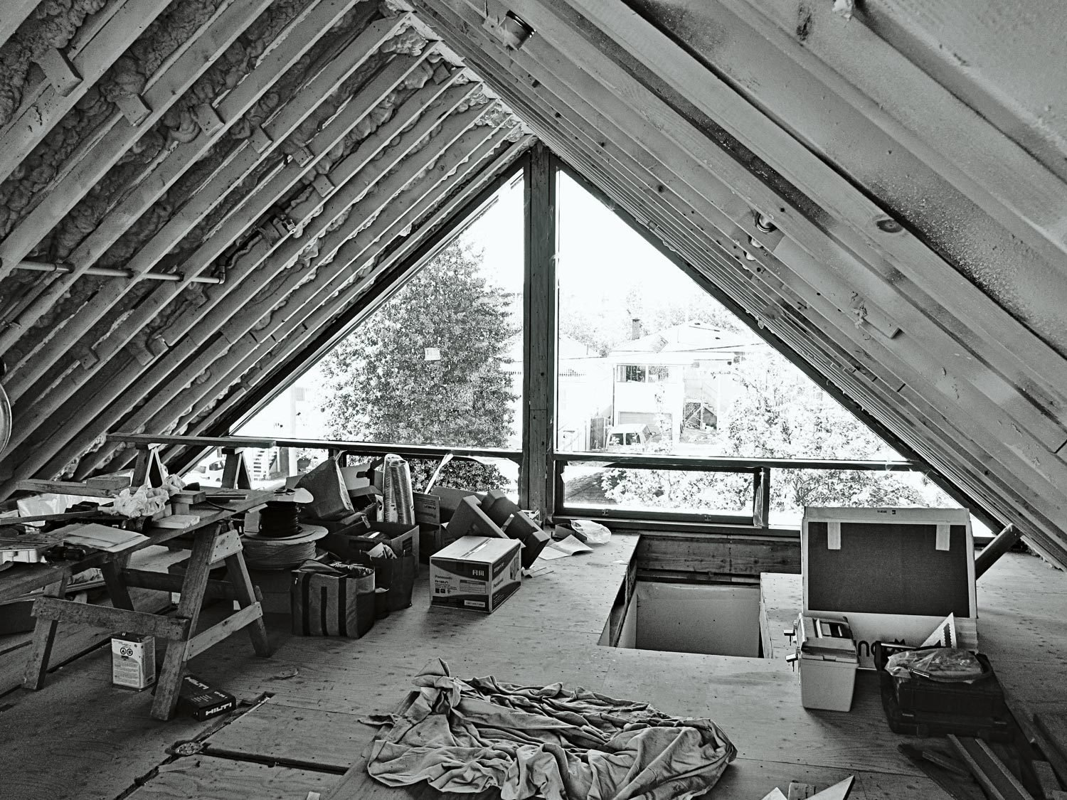 """""""We tried to envision just two floors, but once summer arrived we decided that we were going to tear the roof off and put on that triangle with windows.""""  Photo 8 of 11 in This Bungalow is Anything but Basic"""