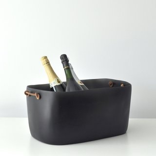 Tina Frey Large Champagne Bucket, $300<br><br>This large bucket is the perfect home for some bottles of bubbly. It is handcrafted from resin in Tina Frey's Bay Area studio.