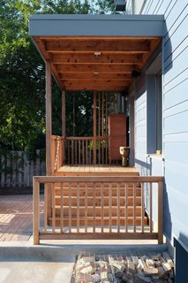 A cedar deck and beams create the transition to the back entry.<br><br>Photo by: Eric Hausman Photography