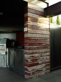 Burgum opted for locally sourced reclaimed wood from a demolished barn to build sections of the pergola covering the cookspace.<br><br>Photo by: David Bowman