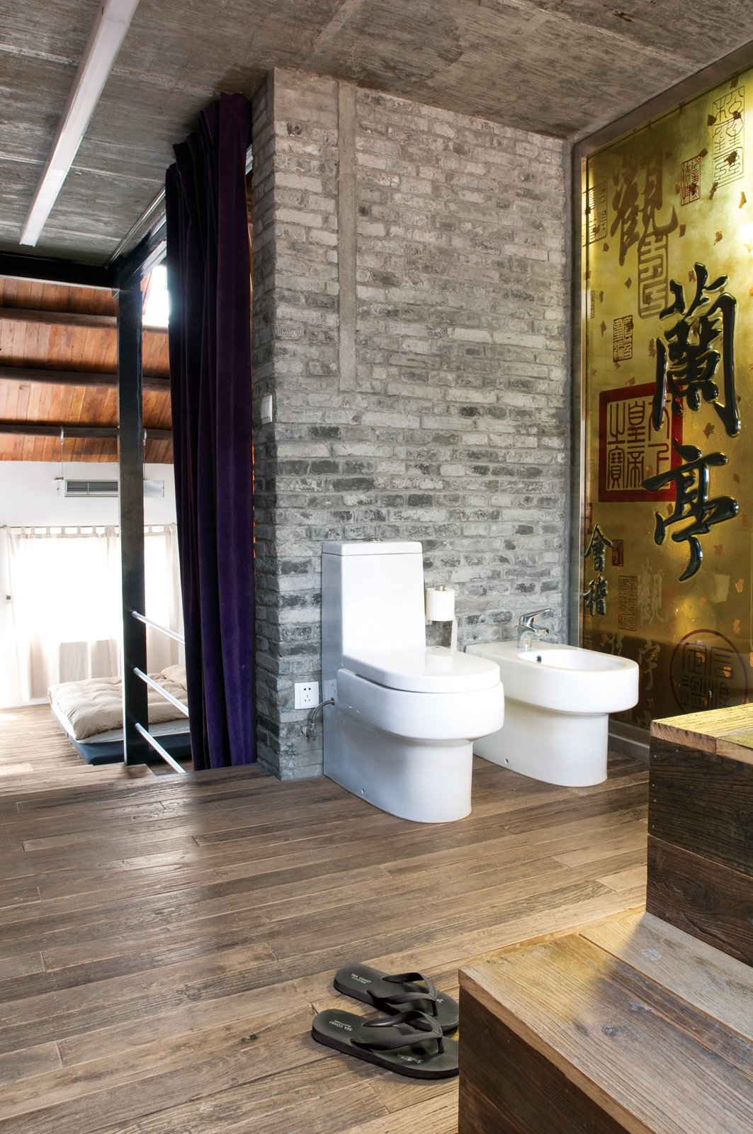 Bath Room, Medium Hardwood Floor, and One Piece Toilet A yellow glass panel divides the shower from the toilet and the bidet.  Photo 9 of 11 in Modern Lilong House Renovation in Shanghai