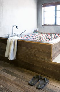 All of the floorboards in the house, as well as the wooden panels encasing the bathtub in the main bathroom, are made of antique door frames.