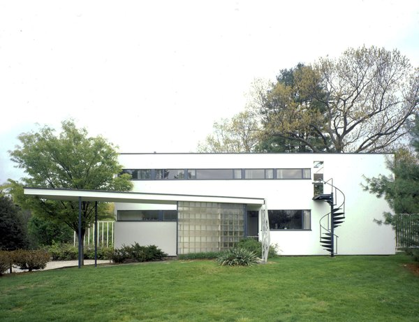Gropius House, Walter Gropius, 1938, Lincoln, Massachusetts.  When Bauhaus founder Walter Gropius moved to the United States, he settled in Lincoln, Massachusetts, where he built his family home. The house is modest in scale yet revolutionary in impact, embodying the Bauhaus principles of simplicity, economy, and restrained beauty. It combines traditional elements of New England architecture—wood, brick, and fieldstone—with innovative materials rarely used in domestic settings at that time, including glass block, acoustic plaster, chrome banisters, and the latest technology in fixtures. The house is recognized as a National Historic Landmark for its influence in bringing international modernism to the United States. A Getty grant will support the development of a conservation management plan for the building and site, to ensure the preservation of its characteristic features for the home's continued use as a teaching tool to transmit the tenets of Bauhaus design. Grant support: $75,000