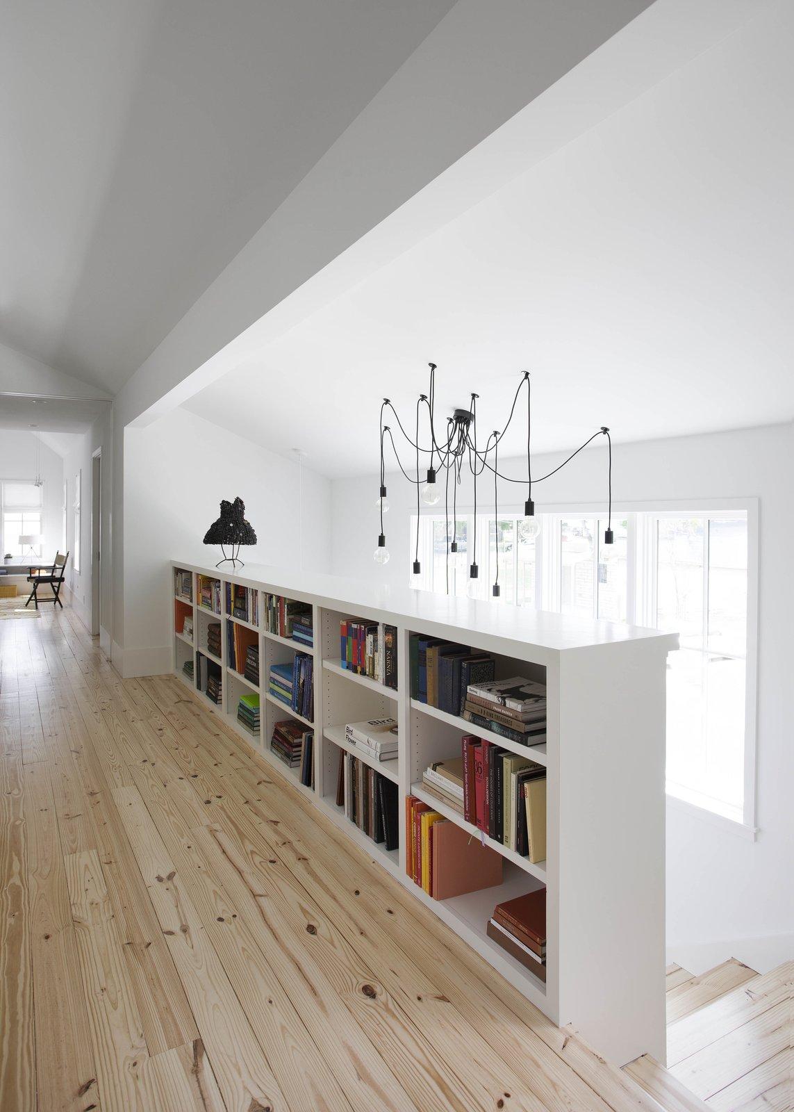 modern texas farmhouse hallway with bookcase