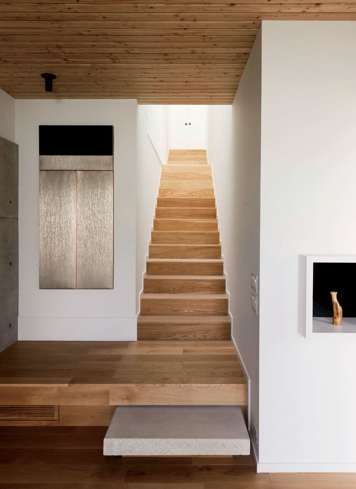 Staircase White-oak stairs connect the first-floor living spaces with the upstairs sleeping areas.  Photo 10 of 17 in A Texas Couple Builds Their Cast-In-Place Concrete Dream Home