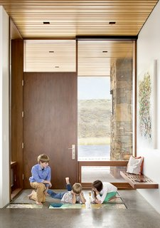 A Custom, LED-Lit Slide Twists Through This Family-Friendly Vacation Home - Photo 2 of 11 - Steve Conine, a software engineer, installed and programmed many of the details himself, like the Dell UltraSharp flat-screen panels inlaid into the entryway of the home.