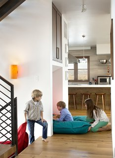 A Custom, LED-Lit Slide Twists Through This Family-Friendly Vacation Home - Photo 5 of 11 - An interior slide was the first of the unexpected amenities the homeowners requested.