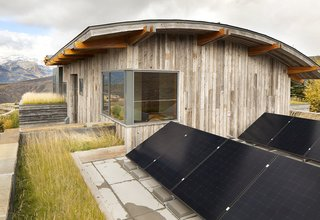 Rooftop Sunpower X-Series solar panels installed by Creative Energies of Victor, Idaho, generate about a third of the energy for the house over the course of the year. On clear, sunny summer days, they can provide energy for the entire house. Another green feature, the planted roof, was inspired by a trip to Norway.