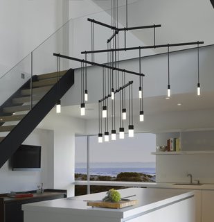 """One of the ways Suspenders can be arranged is in a Tri-Bar configuration. Hanging from a ceiling-mounted outlet box transformer is a 24"""" tri-bar that supports three 36"""" linear power bars, each with five LED luminaires."""