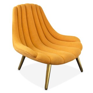 Adler's shell-esque Brigitte Chair with brushed brass legs.