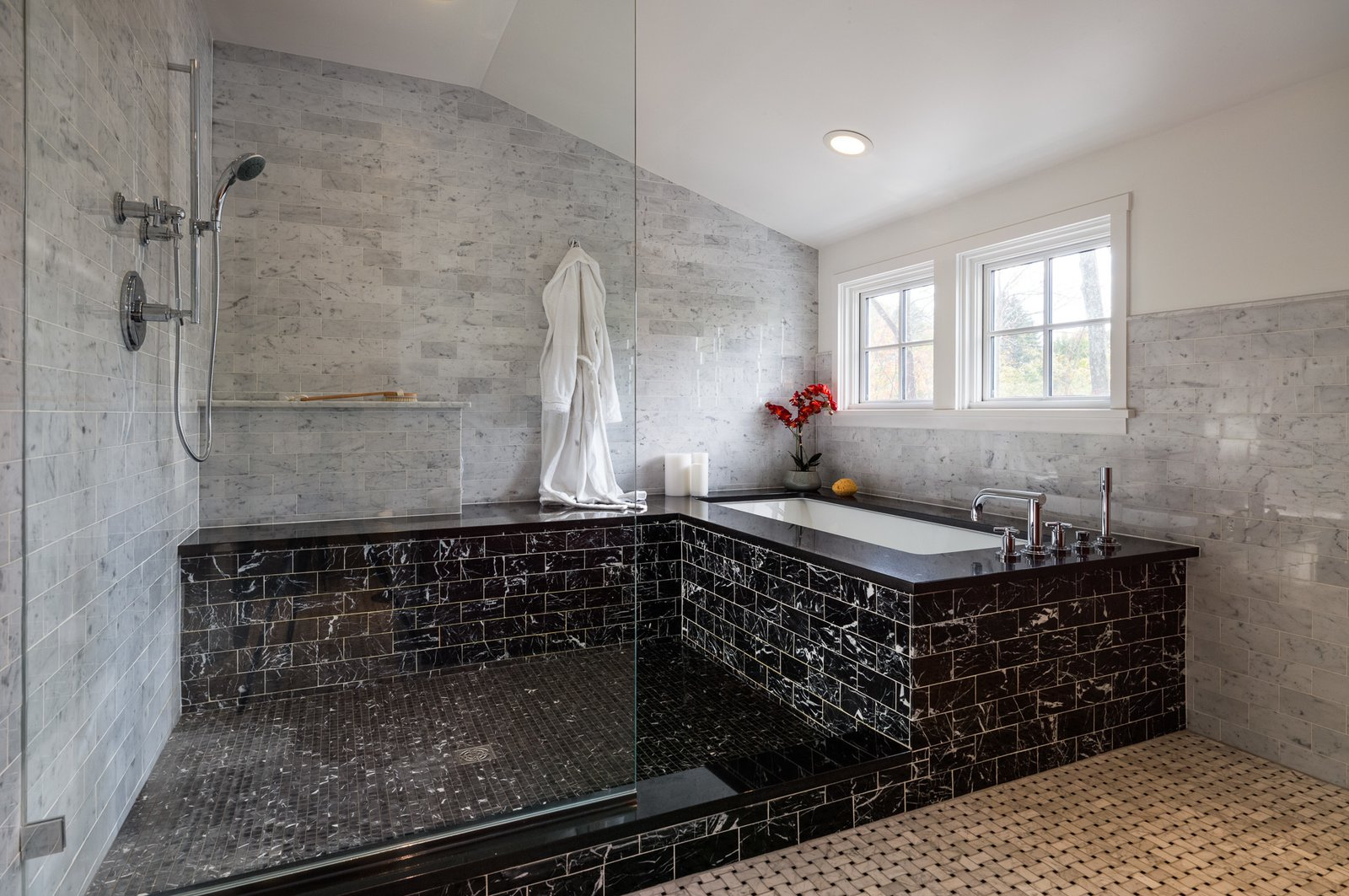 """Marble was used throughout the master bathroom in order to create a timeless feel that would age well. """"The hope is that in 15 years, you won't look at the room and think, 'oh, that tile was only popular in 2015,"""" Michael says.  Photo 6 of 8 in A Loving Renovation Updates a Rustic Family Home with Reclaimed Materials"""