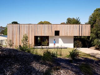 Rachel Nolan and Steven Farrell's weekend house is located a couple of blocks from the beach on Australia's Mornington Peninsula. Built with passive principles in mind, the low-slung structure features double-thick brick walls for thermal massing. The vertical wood cladding is unfinished spotted gum, a local timber.