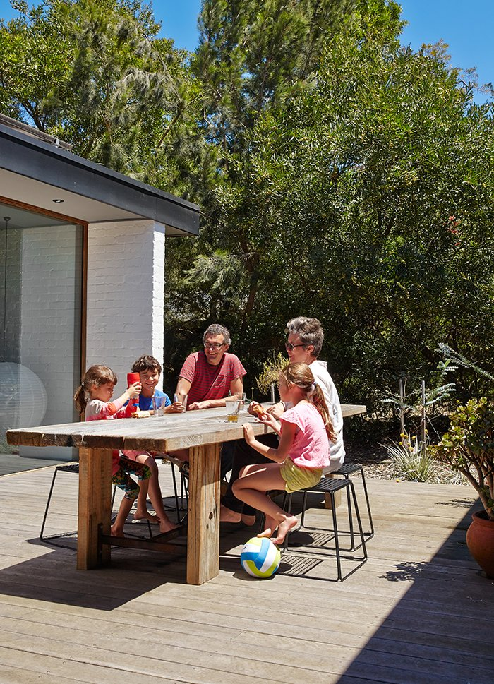 Outdoor, Side Yard, Front Yard, Back Yard, and Wood Patio, Porch, Deck The house has three outdoor deck areas.  Photo 8 of 11 in Simplicity Rules at this Family Beach House Designed to Double as a Rental