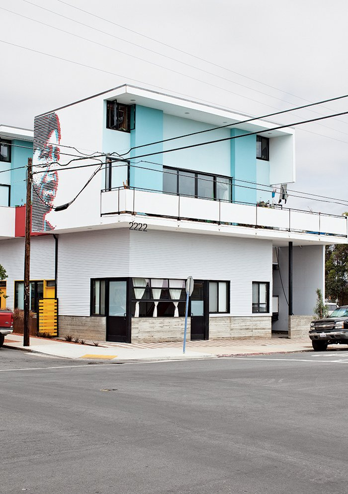 Exterior, Flat RoofLine, and House Building Type The building's exterior includes a 3-D mural of Cesar Chavez conceptualized by Perez's son, Adrian.  Photo 8 of 14 in San Diego Teaches Us How Micro-Living Can Thrive