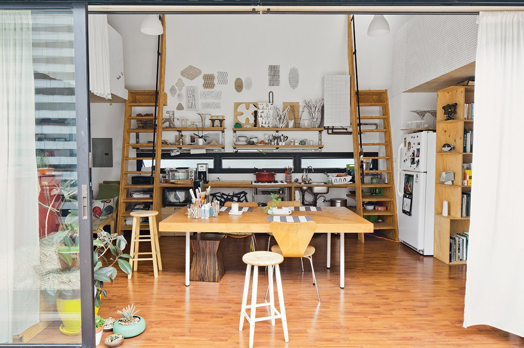 Dining Room, Chair, Shelves, Storage, Ceiling Lighting, and Table Like the other larger upstairs units, Puzio's includes two loft spaces flanking the kitchen, whereas those below have one.  Photo 6 of 14 in San Diego Teaches Us How Micro-Living Can Thrive
