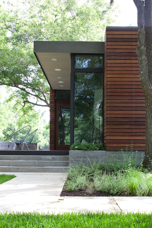 Exterior, House Building Type, and Wood Siding Material  Photo 6 of 6 in Small and Modern: A Family Lakeside Getaway in Texas
