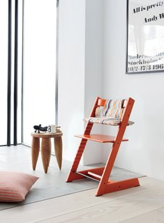 An artful reminiscence of Rietveld's 1934 Zig-Zag chair—with a spare, wooden geometric frame in the shape of a letter Z, and bearing a name equally alliterative—the iconic Tripp Trapp, designed by Peter Opsvik, distinguishes itself from other high chairs in that it allows children to sit closer and more intimately to the family dining table.