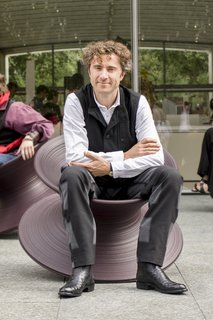 Thomas Heatherwick seated in the Spun chair he designed in 2010. Made from rotational moulded polyethylene, it's designed by a single profile rotated 360 degrees around an axis.