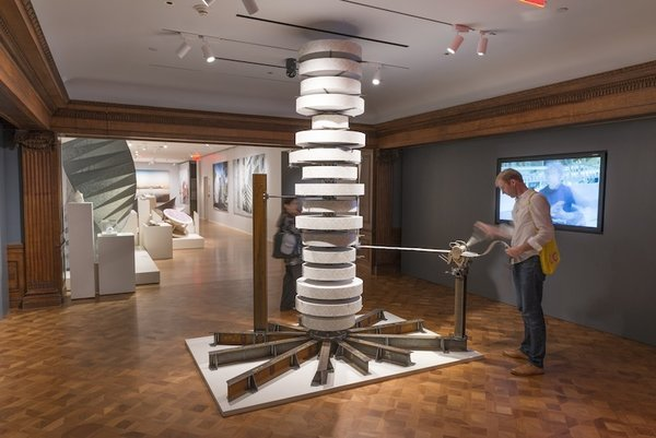 Q&A With British Designer Thomas Heatherwick - Photo 2 of 10 - Entering the show, viewers are prompted to crank a large mechanical device for a takeaway exhibition brochure—a fitting representation of Heatherwick Studio's inventive, tinkering approach to design.