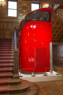 A section of Heatherwick's new bus design, barely clearing in size for an installation within the main staircase of the Cooper Hewitt, emphasizes its impressive scale.