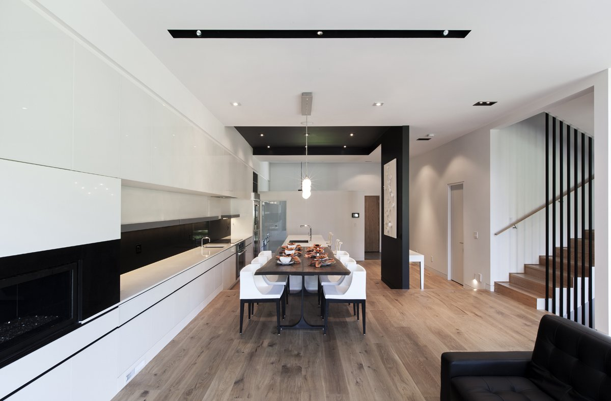 Kitchen, White Cabinet, and Medium Hardwood Floor The recessed black ceiling introduces a contrast between the kitchen area and other parts of the house.  Photo 3 of 7 in Toronto's Tetris Inspired Home