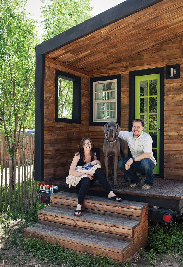 Exterior, Tiny Home Building Type, and Wood Siding Material Boise, Idaho–based architectural designer Macy Miller built her own 196-square-foot home, which she shares with her partner, James Herndon, their newborn, Hazel, and the family's Great Dane, Denver. The exterior cladding, which Miller stained for a uniform effect, is a mix of nearly a dozen types of wood plank, including poplar, oak, and fir.  Photo 8 of 10 in 10 Tiny Cabin Homes That Will Have You Headed to the Forest from Tiny House Fits a Family in 196 Square Feet