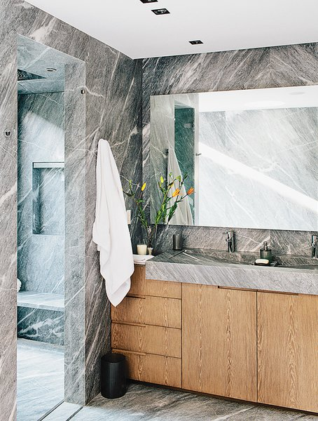 The striking master bath is lined from floor to walls in silvery gray marble.