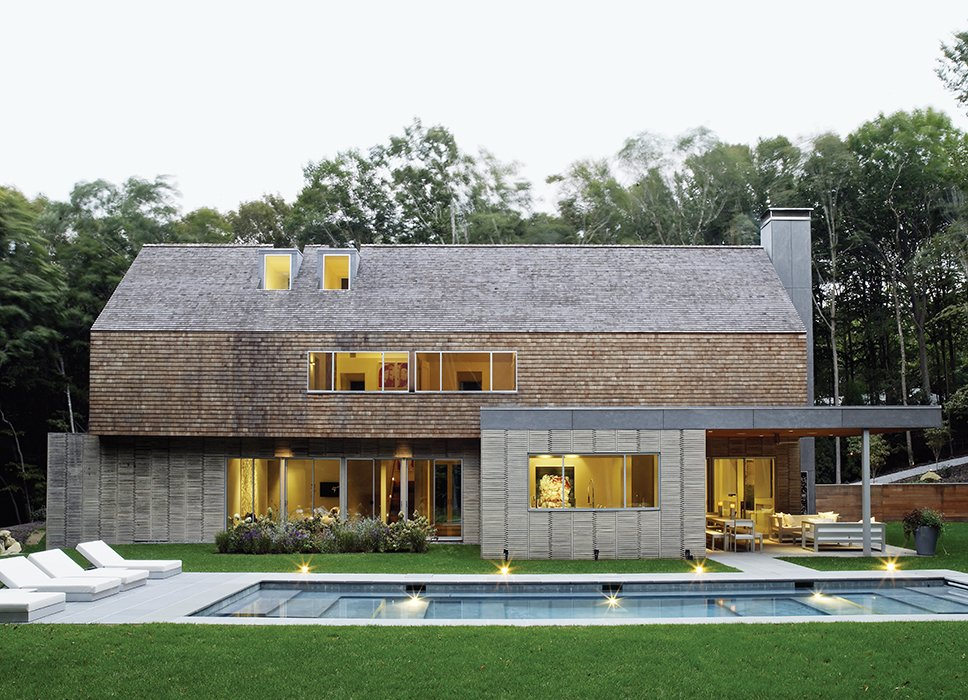 Exterior, House Building Type, Wood Siding Material, Shingles Roof Material, and Gable RoofLine Even the pool is the result of mixed influences: Andrew wanted a series of shallow, gently sloping hangout zones; his wife, Amy, a former competitive swimmer, needed a full lane deep enough for laps.  Photo 1 of 12 in Art-Filled Hamptons Vacation Home