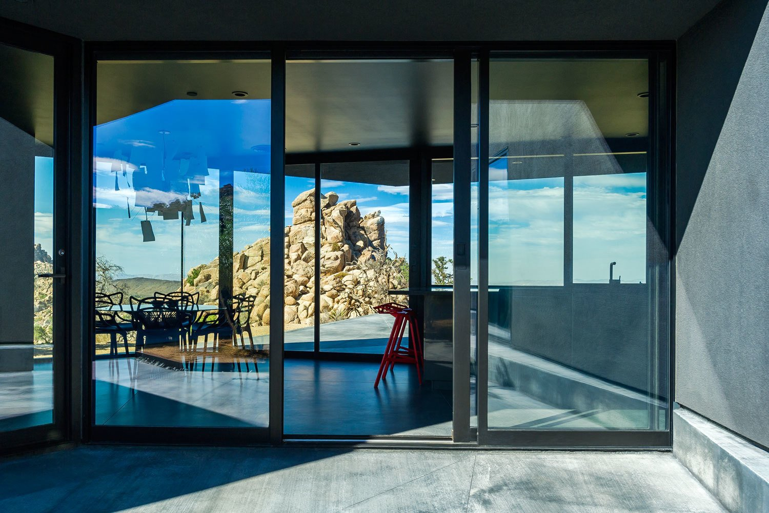 Windows, Metal, and Sliding Window Type An enormous boulder blocks views of the street, enhancing the sense of tranquility.  Photo 7 of 8 in A Sculptural Desert Escape Inspired by a Shadow