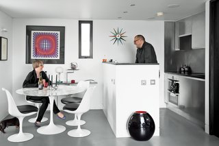 Who says kitchen islands can't work in small spaces too? A design-minded pair ensures that their tiny seaside getaway in Hampshire, England, is shipshape. At 538 square feet, this home is efficiently designed, with an interior that was influenced by the compact housing that you see in Japan. The kitchen and island have been sized to fit the small space, but the island's minimal finishings keep it feeling appropriate.