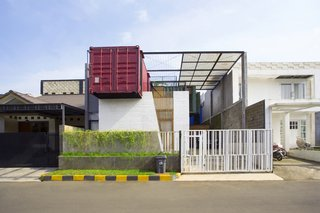 Atelier Riri devised creative ways to make living inside a shipping container in Indonesia's tropical climate both comfortable and economical. The architects layered recycled pine, glass wool, and planter mesh on top of the home to help keep temperatures down.