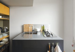 With clever storage and a retractable skylight, a London apartment designed by metalworker and owner Simone ten Hompel and Roger Hynam of Rogeroger Design Solutions feels larger than its 576 square feet. The team worked in a uniquely collaborative way, with Ullmayer Sylvester planning the space, Hynam creating the built-in storage and the kitchen island, and ten Hompel making models and scrawling on the wall to better envision their proposals. The kitchen island features a compact cooktop by Whirlpool and an integrated drainboard incised into the countertop for easy cleaning.