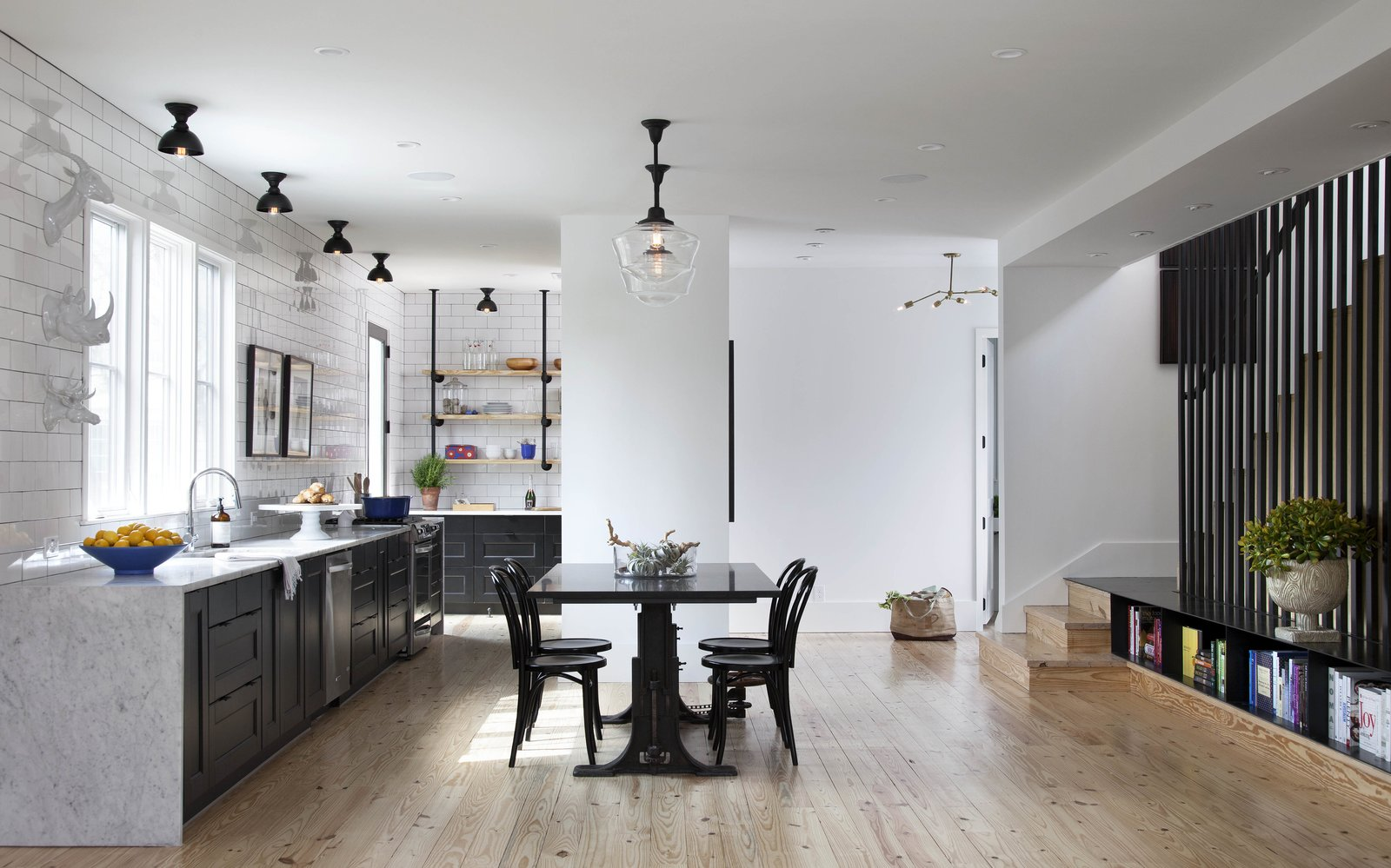 modern texas farmhouse dining room and kitchen with black and white accents