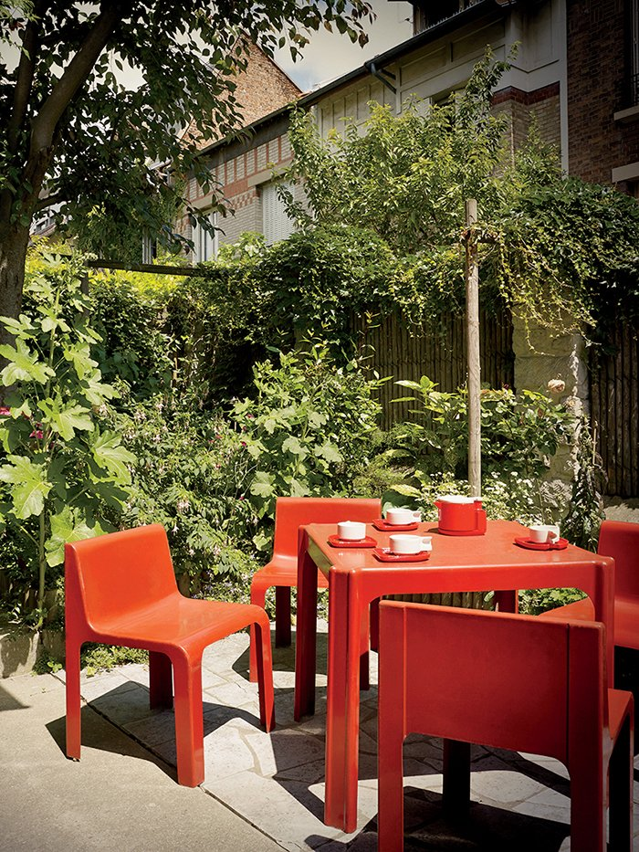 On his patio are a table and chairs from the 1968 Ozoo collection by Marc Berthier for Roche Bobois.  Photo 3 of 9 in This Petite Paris Apartment is a Vintage Furniture–Filled Delight