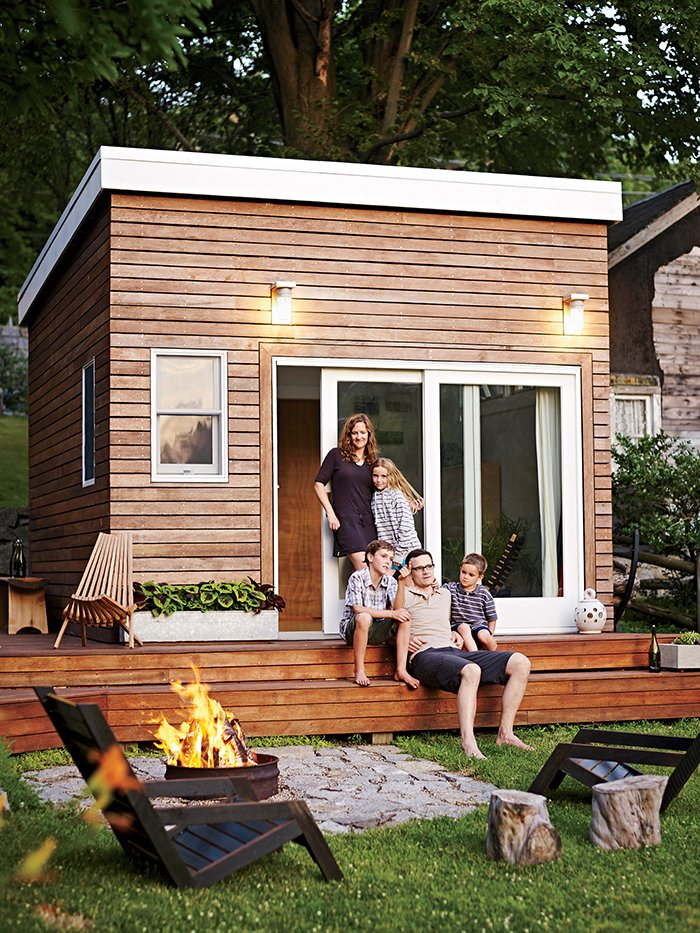 Exterior, Tiny Home Building Type, Wood Siding Material, and Shed RoofLine When the Ferguson Sauder family—parents Meg, a school counselor, and Tim, a design instructor, plus kids Cole, Olive, and Asher—wanted a multifunctional backyard addition, they decided to build it themselves. Two Liftoff chairs by Tim Miller, one of Tim's former students, surround an oil-drum fire pit set in granite dug up on the property. On the deck, the Panamericana chair is by Industry of All Nations.  Photo 1 of 8 in A Family Builds a Tiny Backyard Studio on an Even Tinier Budget