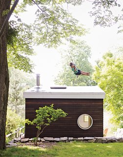 To keep the project close to their $10,000 budget, the family looked for bargains whenever possible. The circular window was a misorder they snagged for 90 percent off from a local building supply store. The mahogany siding is a mix of Craigslist purchases and Dumpster finds.