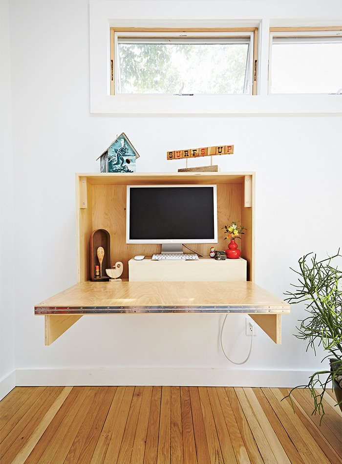 Shed & Studio and Storage Space Room Type A matching desk also folds up and away.  Photo 4 of 8 in A Family Builds a Tiny Backyard Studio on an Even Tinier Budget