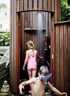 "An outdoor shower was the family's first construction project. ""Doing the shower made us realize we can build things the way we want to build them,"" says Meg."
